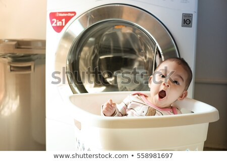 young boy sitting is washing basket stock photo © is2