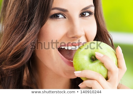 Young girl with apple smiling Stock photo © IS2