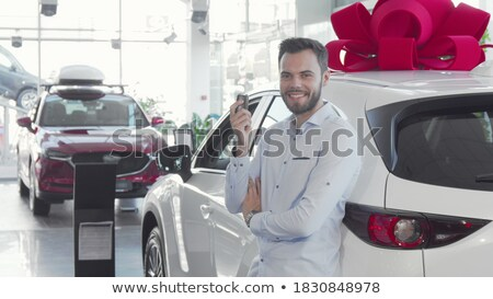 Man proudly showing his key to his car Stock photo © IS2
