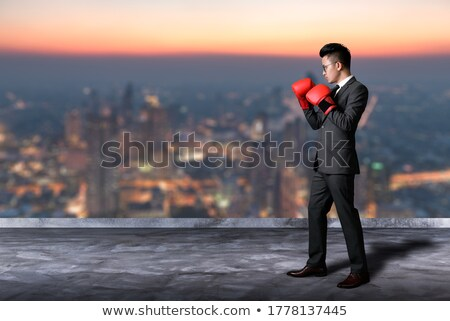 Boxer wearing gloves on urban rooftop Stock photo © IS2