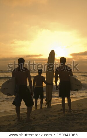 Three people carrying surfboards Stock photo © IS2