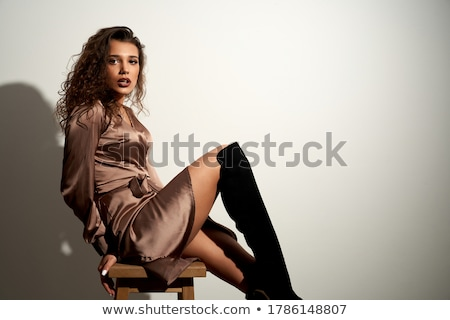 side view of elegant woman in black dress posing seductively Stock photo © feedough