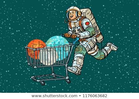 Astronaut on sale. shopping cart trolley Stock photo © studiostoks