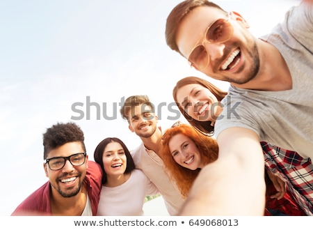 Group of young positive multiethnic men Stock photo © deandrobot