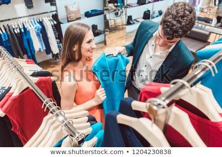 Kadın ikna ortak satın alma yeni elbise Stok fotoğraf © Kzenon