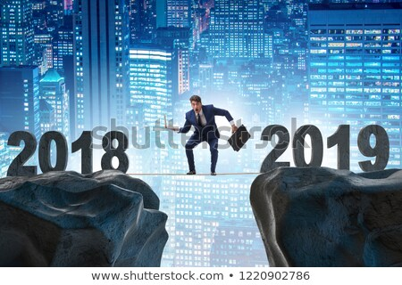 The businessman balancing between 2018 and 2018 Stock photo © Elnur