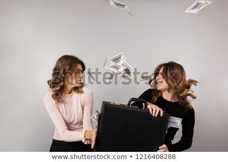 Image of two teenage women fighting for diplomat with dollars mo Stock photo © deandrobot