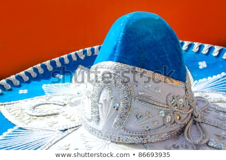 charro mariachi blue mexican hat detail over orange Stock photo © lunamarina