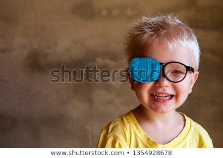 Man in glasses with strabismus  Stock photo © ichiosea
