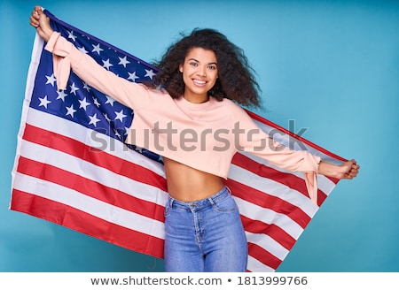 happy african woman posing isolated over black wall holding chips stock photo © deandrobot