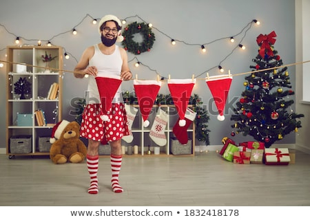 Merry Christmas Santa Claus and Elf at Home Room Foto stock © robuart