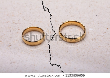 Two Wedding Rings On Cracked Surface Stock photo © AndreyPopov