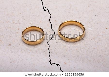 два · обручальными · кольцами · треснувший · поверхность · пару · кольца - Сток-фото © andreypopov