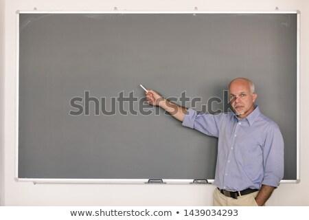 Kıdemli öğretmek tebeşir işaret kara tahta Stok fotoğraf © Giulio_Fornasar