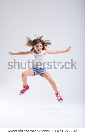 Hyperactive little girl leaping into the air Stock photo © Giulio_Fornasar