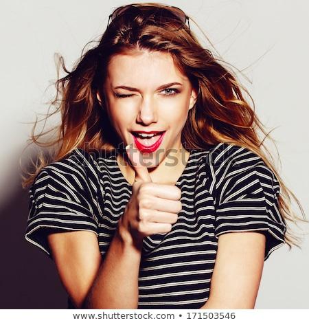 teenage girl showing ok over natural background Stock photo © dolgachov