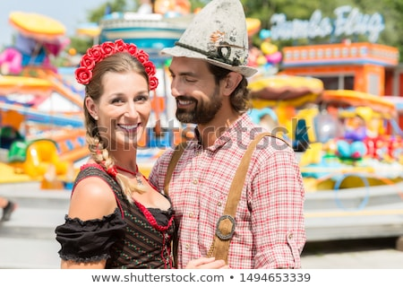 Couple having fun on Bavarian fair or Oktoberfest Stock photo © Kzenon
