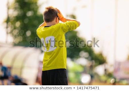Triest voetbal doelverdediger teleurgesteld jongen Geel Stockfoto © matimix