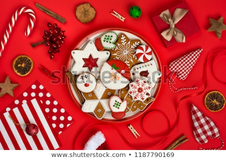 Christmas background, gingerbread cookies, candy canes and anise stars laying on white wooden backgr Stock photo © ikopylov