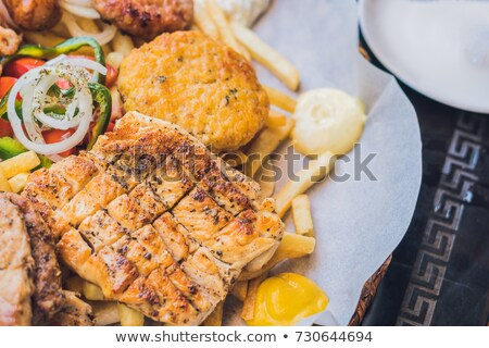 big set greek food meat plate with potatoes and sauce stock photo © galitskaya