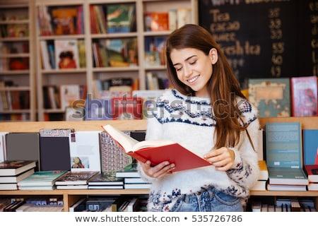 Female Customer Reading Book In Bookstore Stock photo © HighwayStarz