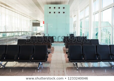 Empty Airport Terminal Chairs. French Windows. Stock photo © ShustrikS