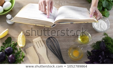 housewife preparing and reading with a book recipe stock photo © vladacanon