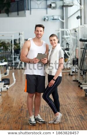 Geschikt aantrekkelijk naar tablet paar Stockfoto © Jasminko