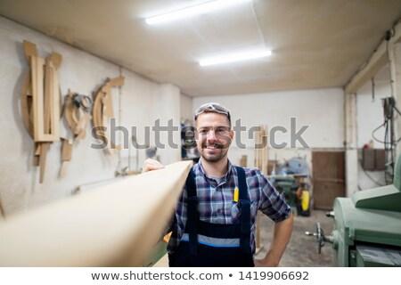 Fiatal buzgó ács üzlet mosoly épület Stock fotó © photography33