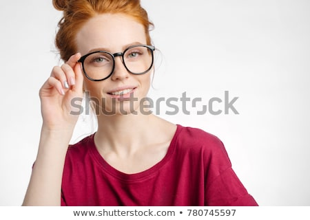 Woman holding glasses to face Stock photo © photography33