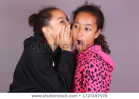 teenager whispering at her surprised sister stock photo © rob_stark