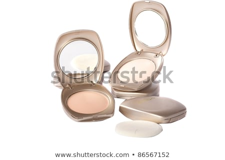 Woman applying mascara looking at a compact mirror Stock photo © photography33