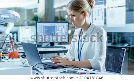 nő · számítógéppel · alaplap · nő · fekszik · tart · számítógép - stock fotó © smithore