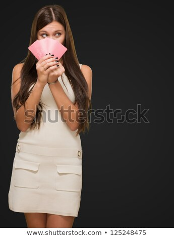 Pretty woman holding gambling cards stock photo © imarin