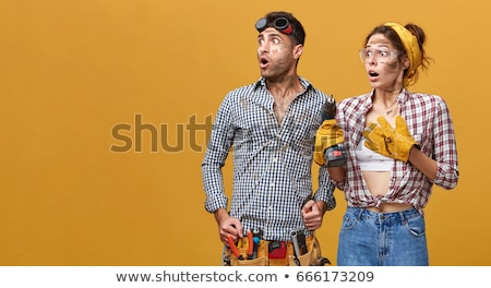 Stock photo: Female electrician with a power drill