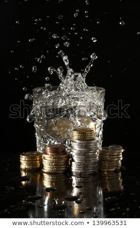 Coin Hitting Water Splash Stock photo © albund