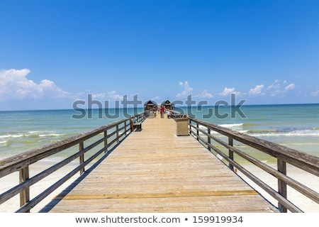 Midday at Naples pier on beach Golf of Mexico Stock photo © meinzahn