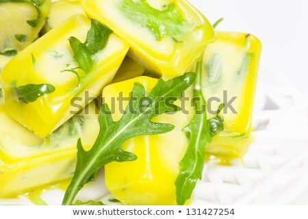 Yellow pepper in ice cube Stock photo © Givaga
