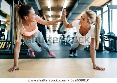 Beautiful girl in the gym Stock photo © racoolstudio