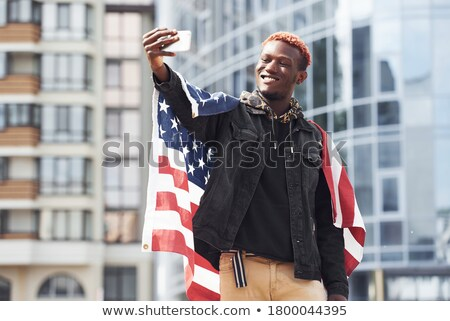 A young man holding a black flag Stock photo © redshinestudio