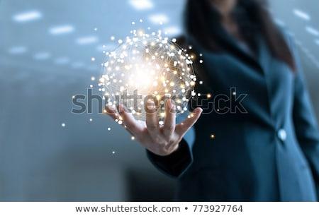 business woman holding globe stock photo © hasloo