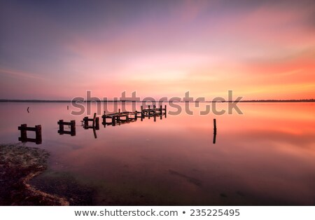 Serene water and stunning sunrise at Gorokan Jetty Australia Stock photo © lovleah