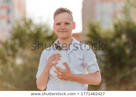 Cute little boy with his pet bunny Stock photo © wavebreak_media