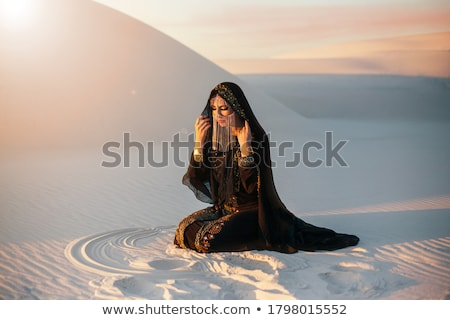 Beautiful model with a long black veil Stock photo © jrstock