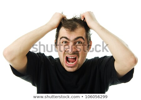 Angry business man tearing hair in despair Stock photo © Kzenon