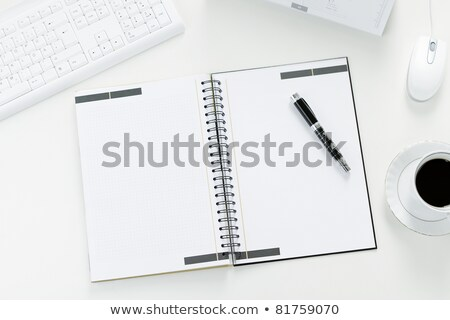 Stock photo: Open blank white notebook and pen with cup of coffee