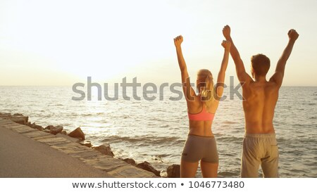 Young sporty man athlete running at the rocky beach Stock photo © deandrobot