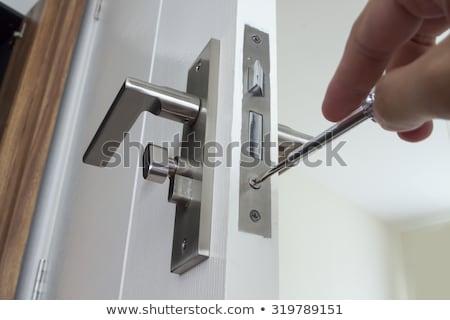 Carpinteiro porta trancar jovem casa Foto stock © AndreyPopov