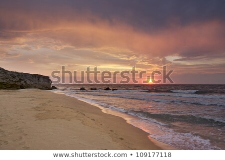 Deserted beach at sunset Stock photo © akarelias