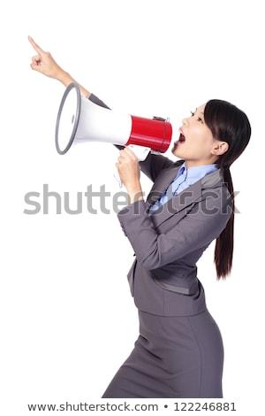 Asian business woman talking into loudspeaker. Stock photo © RAStudio